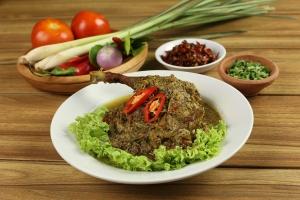 the uma bali balinese restaurant bebek betutu steam duck cuisine